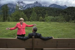Angela Merkel gestures to Obama
