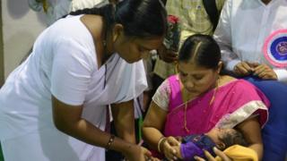 Nurse administers vaccine in Kerala