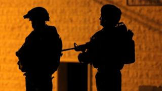 Israeli soldiers are seen during a night raid in Hebron, in the occupied West Bank (15 June 2016)