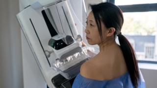 Patient getting a mammogram exam