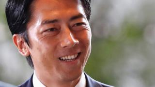 Japan's new Environment Minister Shinjiro Koizumi arrives to Prime Minister Shinzo Abe's official residence in Tokyo