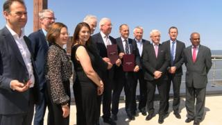 Ministers standing in front of the Grimsby dock tower