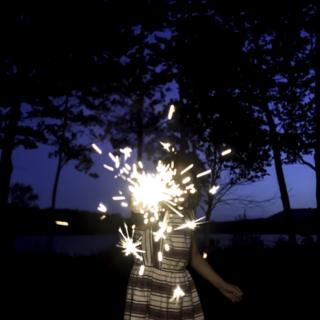 A child with a sparkler