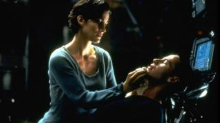 Carrie-Anne Moss and Keanu Reeves star in the original 1999 film