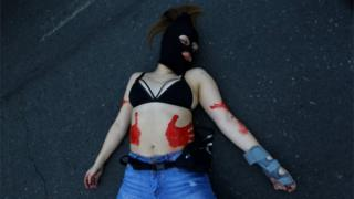 A demonstrator lies on the ground during a march demanding an end to sexism and gender violence in Santiago, Chile June 6, 2018