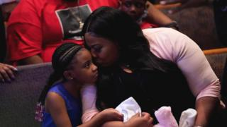 Roxie Washington holds Gianna Floyd, the daughter of George Floyd as they attend the funeral service for George Floyd