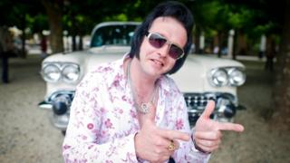 Elvis impersonator Philipp Lieder with a classic Cadillac at the 14th European Elvis Festival in Bad Nauheim