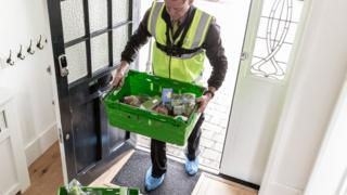 Waitrose delivery man at door