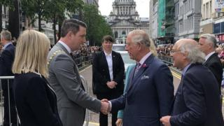 Prince Charles is greeted by the new Sinn Féin Lord Mayor of Belfast, John Finucane