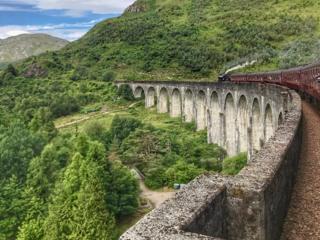 Jacobite steam train on Glenfinnan Viaduct
