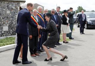 Theresa May is greeted by Catherine, Duchess of Cambridge and Prince William, Duke of Cambridge ahead of a ceremony at the Commonwealth War Graves Commission's Tyne Cot Cemetery in Ypres, Belgium