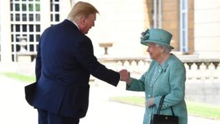 Queen Elizabeth II greets US President Donald Trump as he arrives for the Ceremonial Welcome at Buckingham Palace, London, o