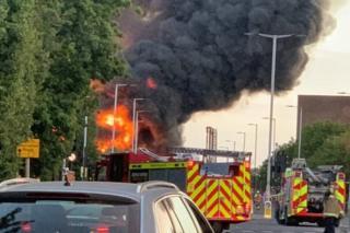 The blaze has created a huge plume of black smoke