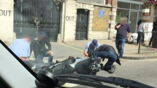 Gang being apprehended