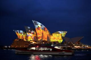 in_pictures The sails of the Opera House in Sydney are lit with a series of images to show support for the communities affected by the bushfires and to express the gratitude to the emergency services and volunteers