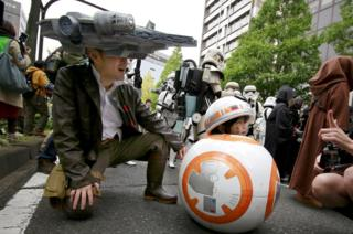 Star Wars fans dressed in costumes pose for a photo during the Halloween parade in Kawasaki, near Tokyo, on October 30, 2016.