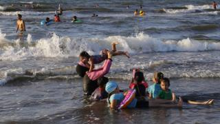 Egyptians enjoy the sea during summer vacation in Port Said, Egypt, 29 July 2018