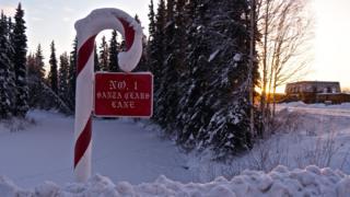 A Candy Cane sign saying Santa Claus Lane