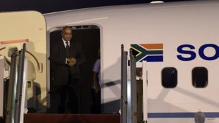 South-African President Jacob Zuma arrives at the Houari-Boumediene international airport in Algiers on March 30, 2015. Zuma arrived in Algeria for a three-day official visit at the invite of Algerian President Abdelaziz Bouteflika.