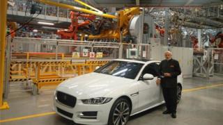 Narendra Modi leaning against a car