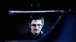 Edward Snowden, shown on a screen