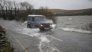 Flood water across the A592 in Cumbria