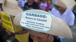 Environmental activists rally outside the Philippine Senate in Manila on September 9, 2015