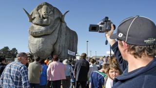 People stand in front of the Big Merino in Goulburn, New South Wales, after it was moved to a new location in 2007