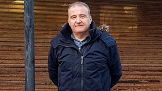 Picture of Lee Castleton outside derelict Post Office