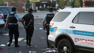 Chicago imposes restrictions after night of unrest