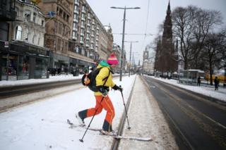 A person skis along Princes Street in Edinburgh