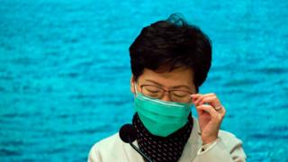 Carrie Lam wears a face mask at a press conference