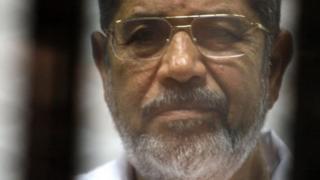 Morsi behind bars
