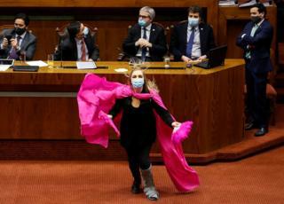 india A congresswoman dances with a purple cape