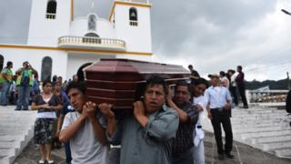 Relatives of a victim of Thursday's landslide in the village of El Cambray II - take the coffin to the municipal cemetery of Santa Catarina Pinula municipality, some 15 km east of Guatemala City, on October 4, 2015