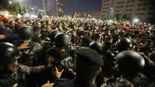 Anti-riot police clash with protesters outside the prime minister's office in Amman, Jordan, on June 4, 2018