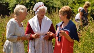 Volunteer costumed interpreters in the garden at Coleridge Cottage