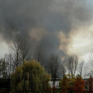 Smoke billows from the Milcamps waffle factory in Forest in Brussels, Belgium, 23 November 2017