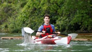"Canada""s Prime Minister Justin Trudeau paddles a kayak to mark World Environment Day on the Niagara River, that borders with the United States, in Niagara-on-the-Lake, Ontario, Canada June 5, 2017."
