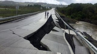Quake-damaged road at Tarahuin, on Chiloe island, southern Chile, December 25, 2016