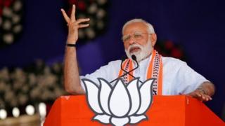 "India""s Prime Minister Narendra Modi addresses an election campaign rally in Junagadh, Gujarat, India,"