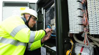 Engineer working on broadband connections