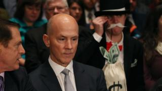 Former Equifax CEO Richard Smith photobombed by Monopoly Man