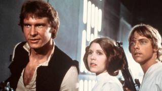 Carrie Fisher with her co-stars Harrison Ford and Mark Hamill