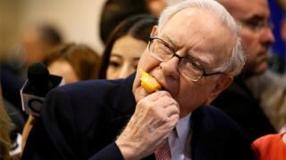 Warren Buffett enjoys an ice cream during one of Berkshire Hathaway's annual shareholder meetings.