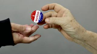 Voters get an 'I Voted Today' sticker after casting their ballots on election day at the Red Oak Fire Department in Red Oak, Iowa - 4 November 2014