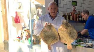 Rex Goldsmith with two fish