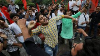 Activists from the Akhil Bharatiya Vidyarthi Parishad (ABVP), the student wing of India's ruling Bharatiya Janata Party (BJP), celebrate after the government scrapped the special status for Kashmir, in New Delhi, India, August 5, 2019.