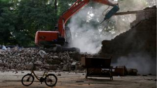 An excavator demolishes Chinese artist Ai Weiwei's art studio in northeastern Beijing, 4 August 2018