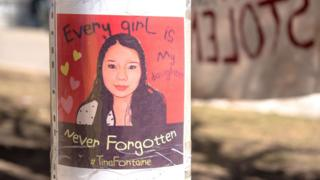 A poster commemorates Tina Fontaine, a young indigenous girl who was killed in 2014